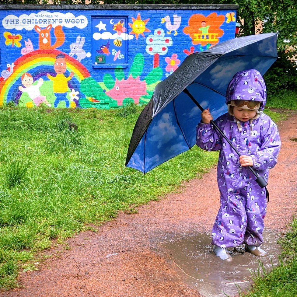 Girl playing in puddle