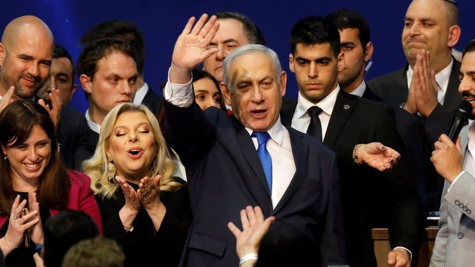 Prime Minister Benjamin Netanyahu celebrates after the exit polls are published for Israel's general election (4 March 2020)