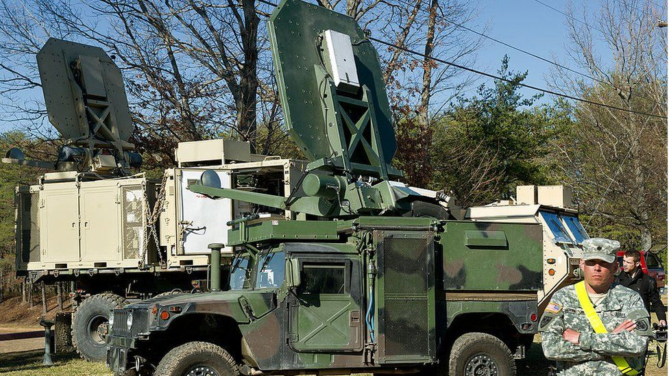 A Marine Corps vehicle with the Active Denial System on top