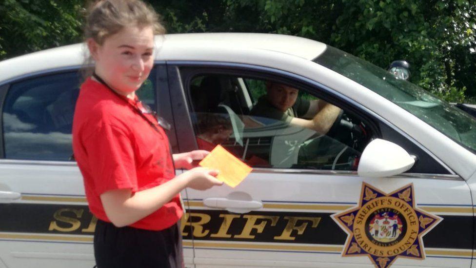 Ffion Jones with a Maryland sheriff