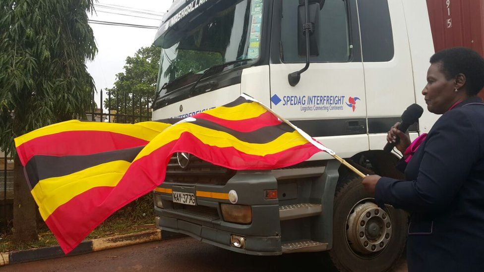 Lady holding Uganda flag