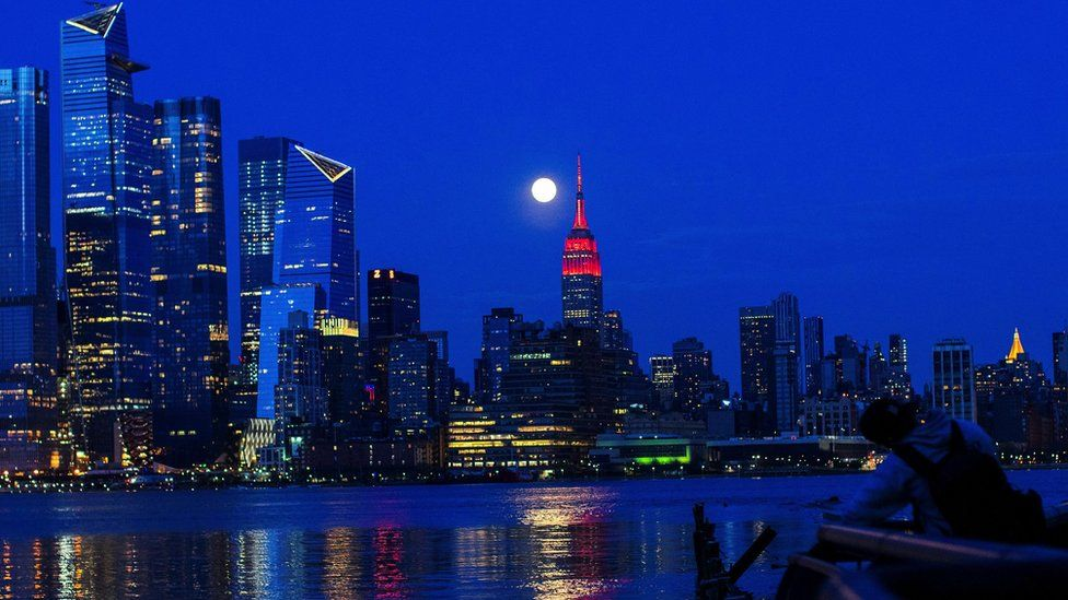 The Supermoon rises behind the Empire State Building - 7 April 2020