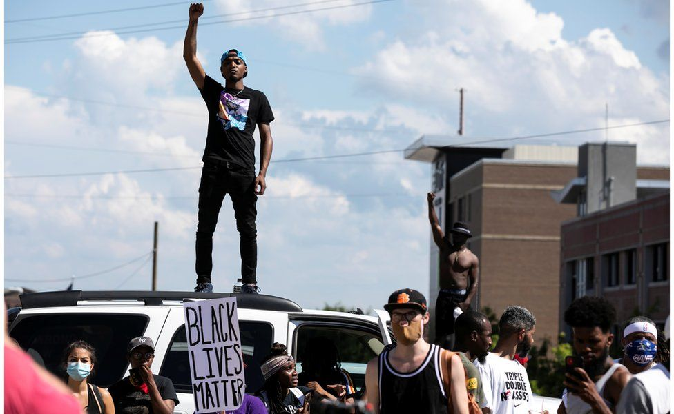 Protesters rally against the death in Minneapolis police custody of George Floyd, in Columbia, South Carolina, 30 May 2020