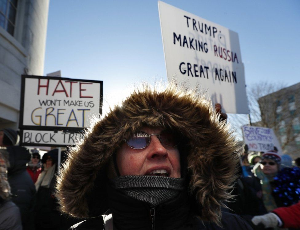 Anti-Donald Trump protesters brave the cold to rally outside the State House in Augusta, Maine, Monday, Dec. 19, 2016.