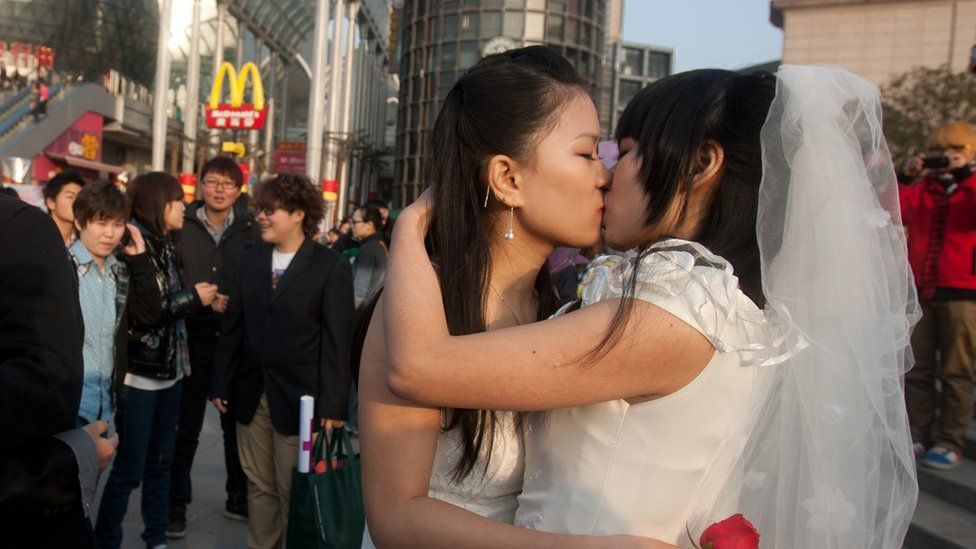 A gay couple kisses at a ceremonial wedding in Wuhan, in China's Hubei province in 2011
