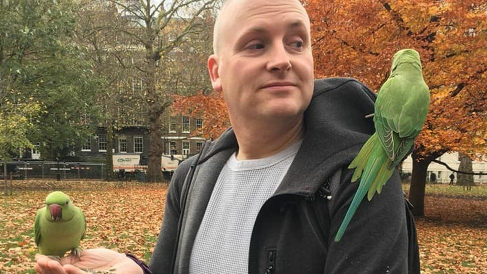Matt Rowan with some parakeets in London