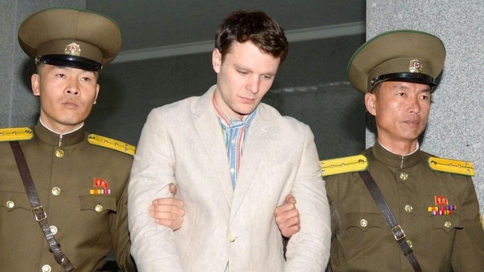 Otto Warmbier is escorted by N Korean guards (image released March 2016)