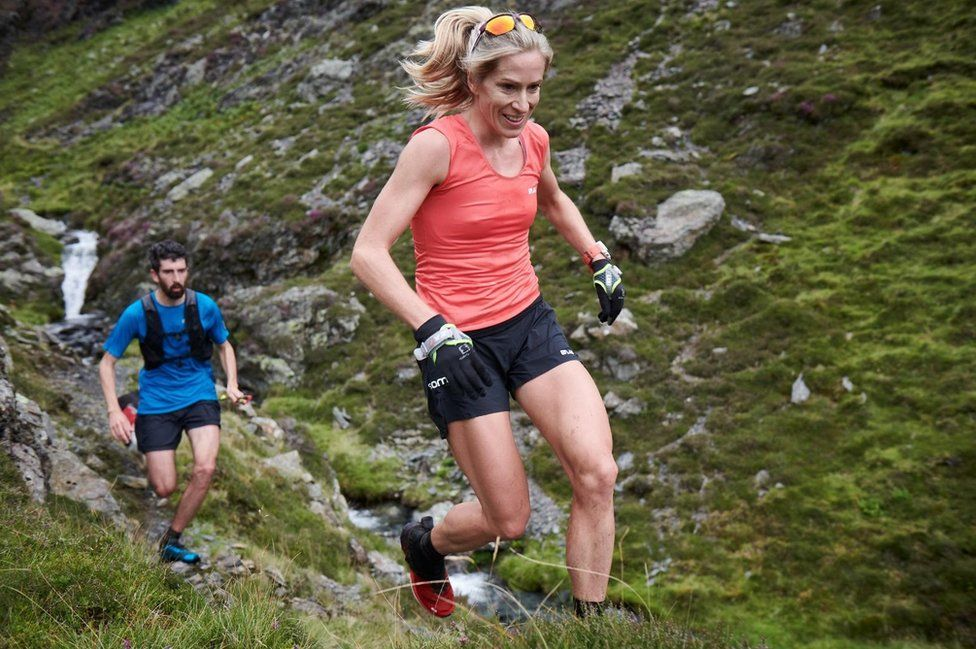 Beth Pascall running across one of the fells as part of the Bob Graham Round