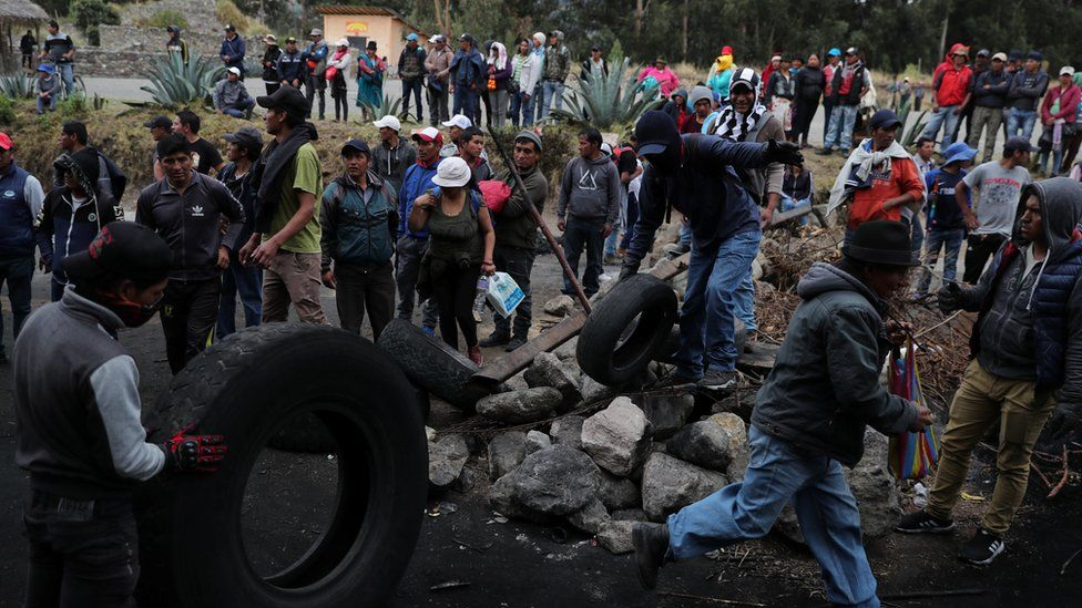 protesters block a road in Cangahua