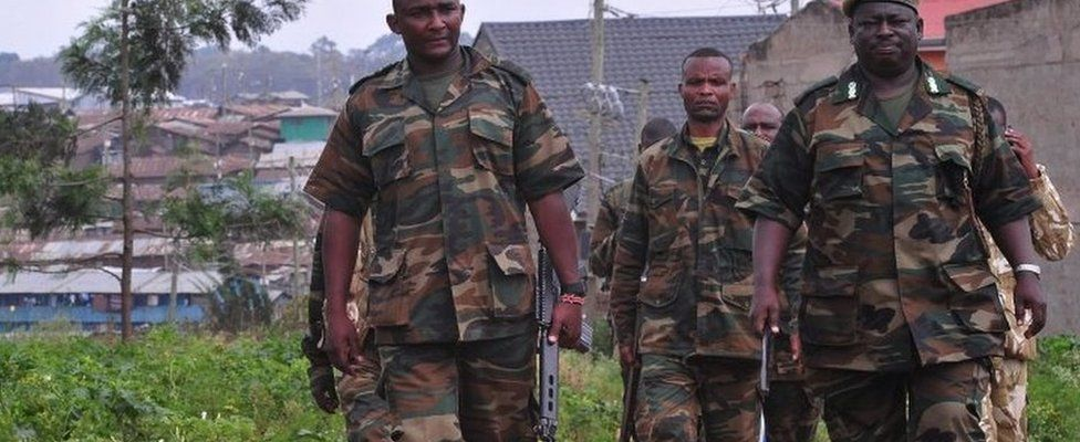 Kenya Wildlife Service (KWS) officers carrying tranquilizer guns