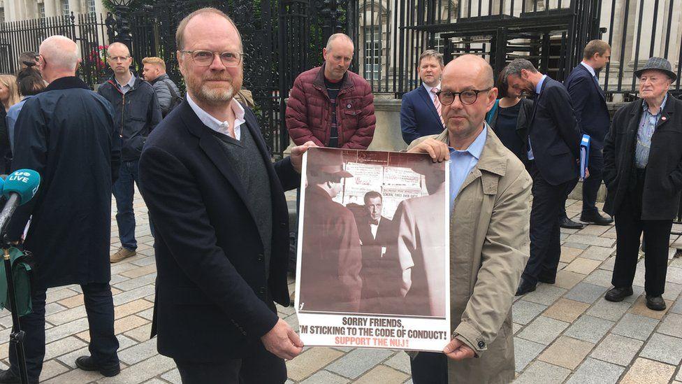 Trevor Birney and Barry McCaffrey with NUJ poster