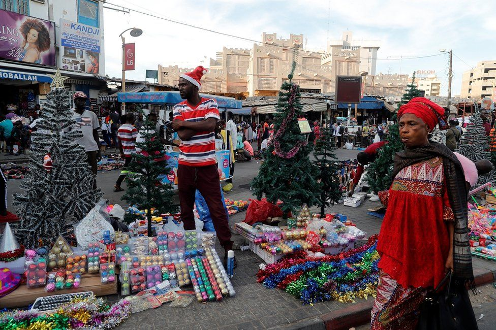 A street vendor sells Christmas decorations on a street in Dakar, Senegal