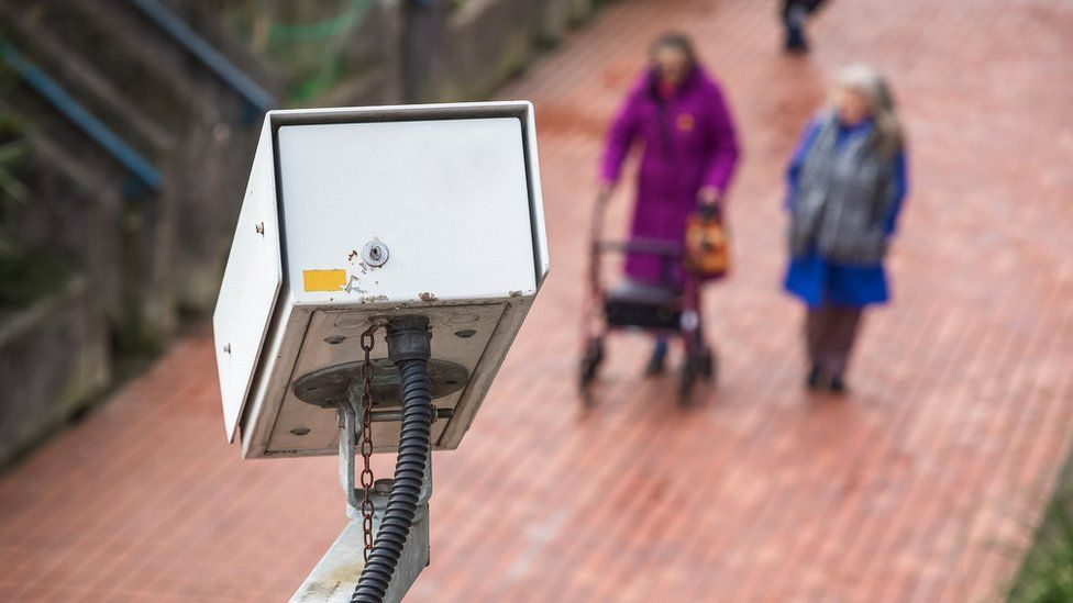 A security camera watching a street