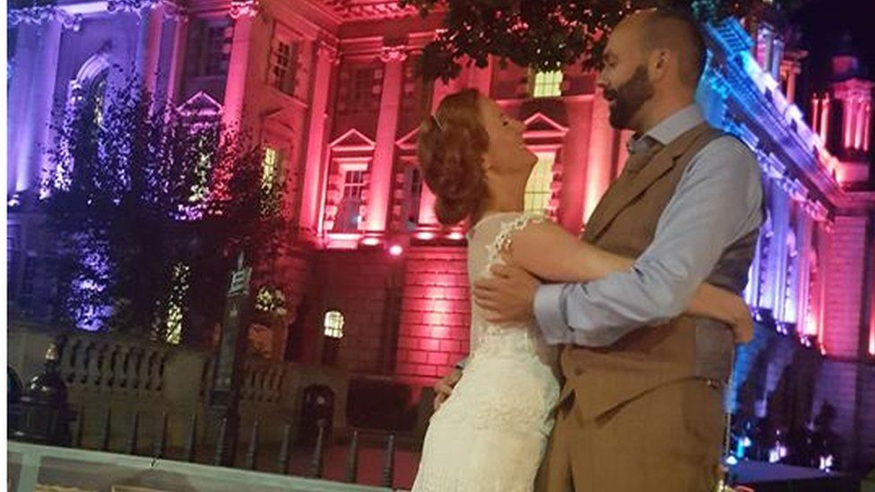 The couple embrace at Belfast City Hall
