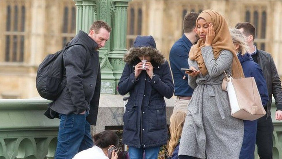 An account identified as a Russian bot shared this picture of a women wearing a hijab after the Westminster terror attack in March, claiming that as a Muslim, she was indifferent to the suffering of victims around her.
