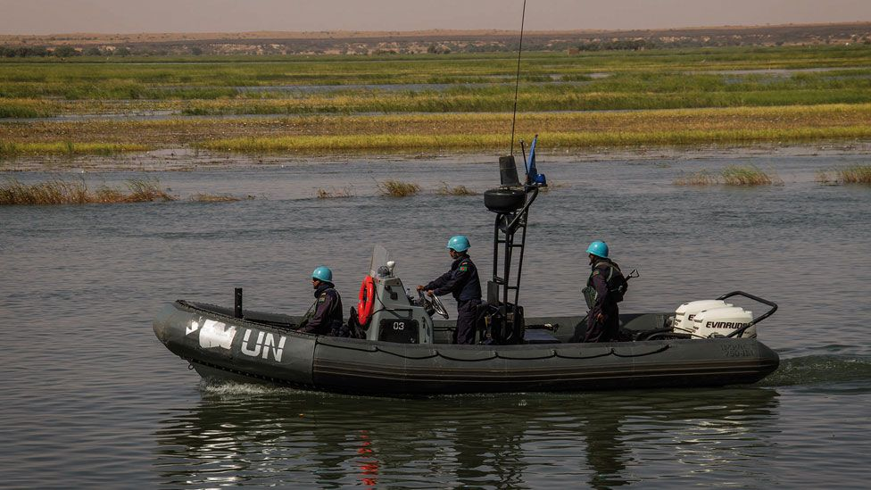 Peacekeepers on boats on the Niger River, Mali