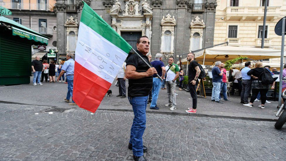 Five Star movement supporter holding Italian flag
