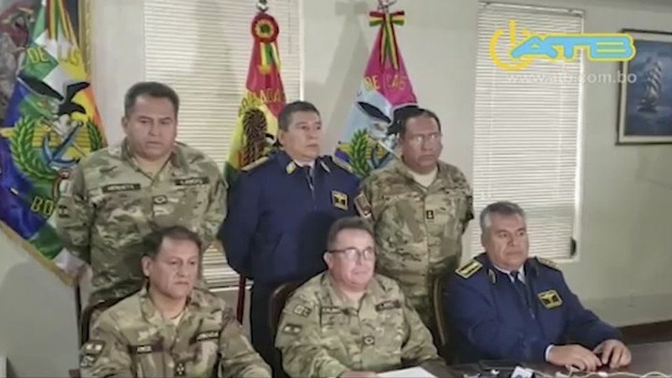 Grab taken from a handout video released by ATB showing the commander in chief of the Armed Forces, Williams Kaliman (C-bottom), speaking in a televised address from La Paz, on November 10, 2019.