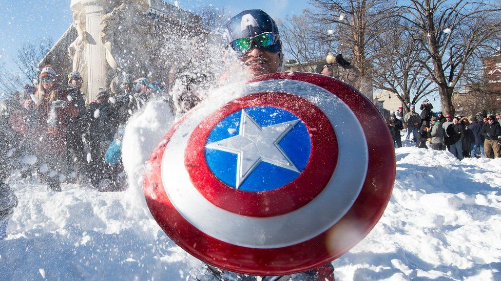 Captain America imitator in snowball fight