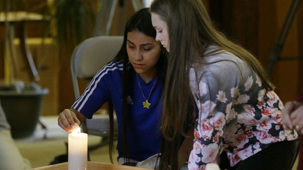 Rachel Marsh, 15, right, and Selena Orozco, 15, left, light candles at prayer service, Sept. 24, 2016, at the Central United Methodist Church in Sedro-Woolley, Washington