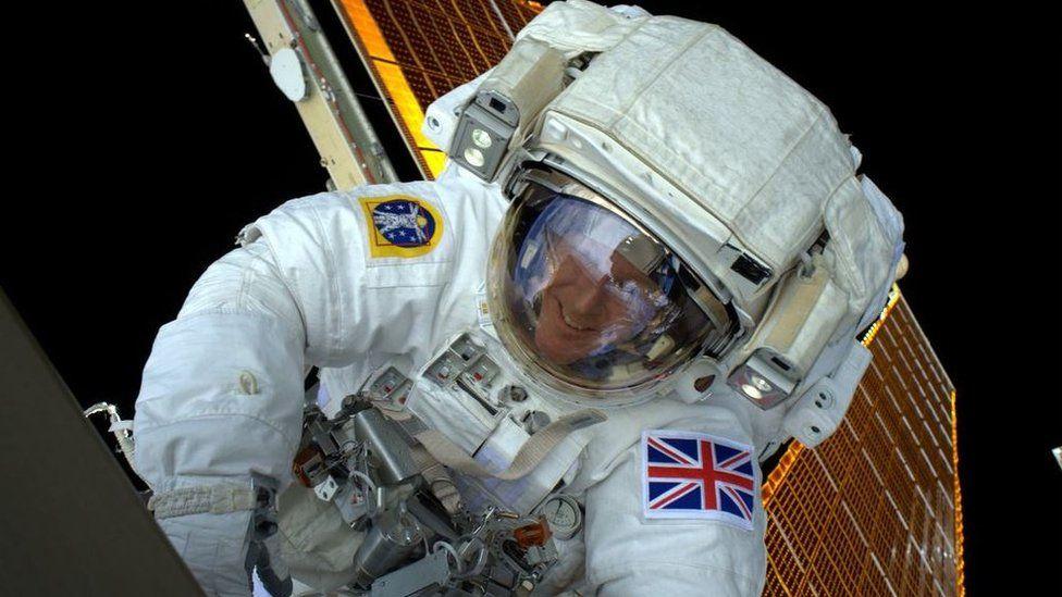 Tim Peake during his spacewalk captured on camera by his colleague Tim Kopra