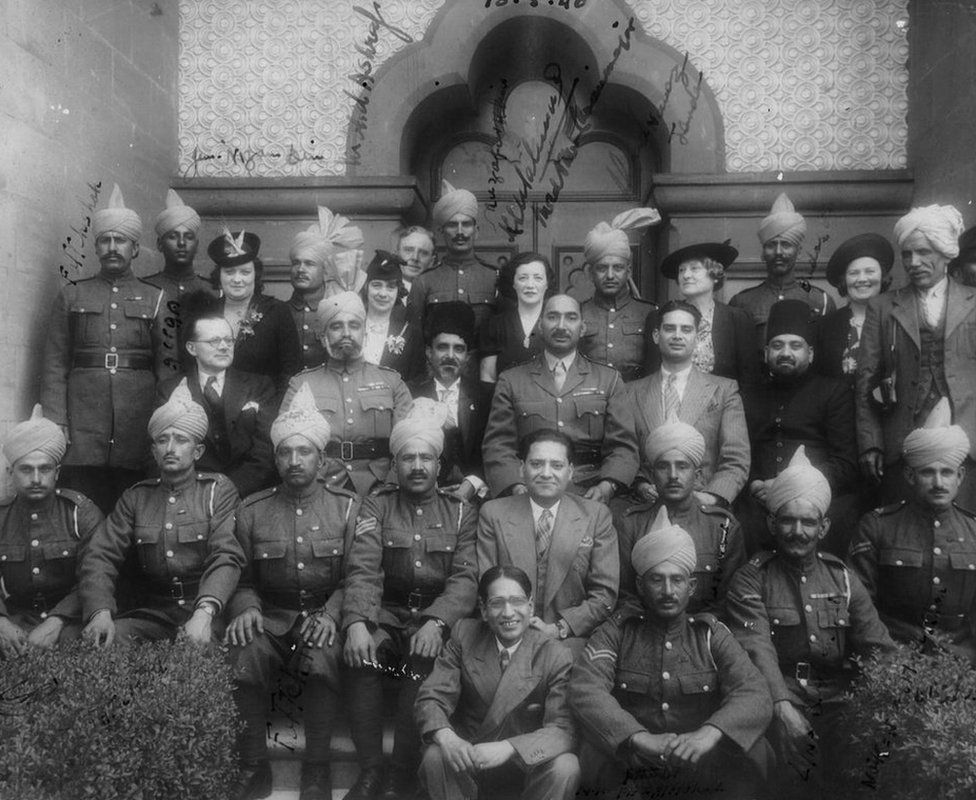 Maj Akbar Khan, bareheaded, in the centre and in uniform, and other Indian soldiers