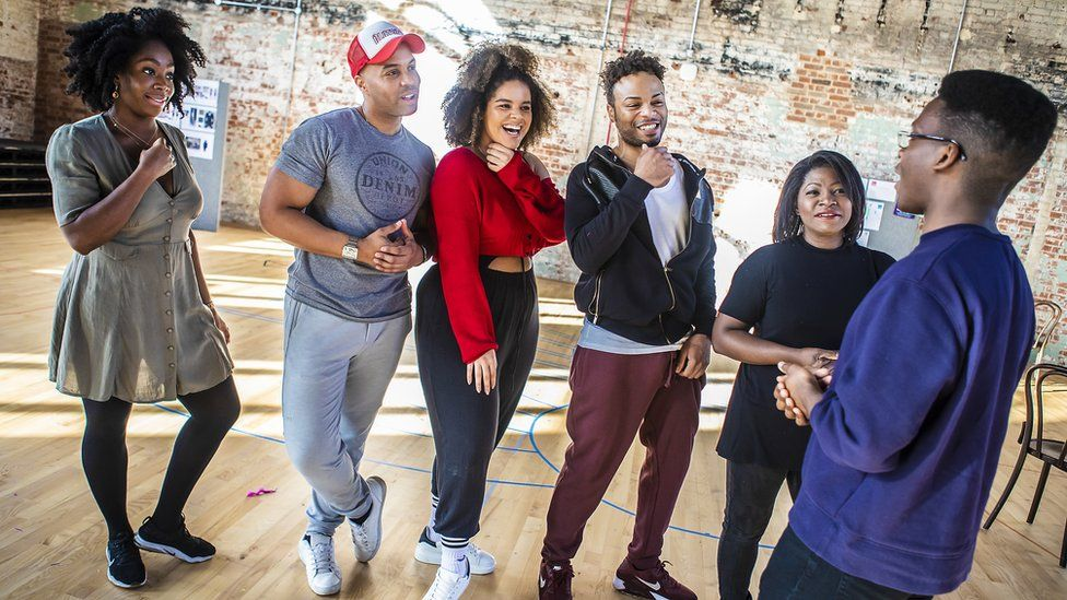 The cast of Ain't Misbehavin' with director Tyrone Huntley