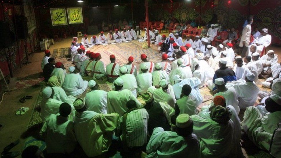 Sudanese men gather for prayer on the eve of the birth anniversary of Islam's Prophet Mohammed in the capital Khartoum on January 12, 2014
