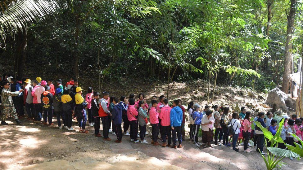 A handout photo made available by the Chiang Rai Provincial Public Relations Office shows people queuing to enter the Tham Luang cave in Mae Sai district, Chiang Rai province, Thailand, on 01 November 2019.
