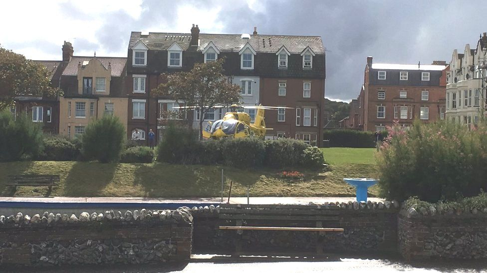The air ambulance at Cromer after a paraglider crashed into The Wellington Hotel
