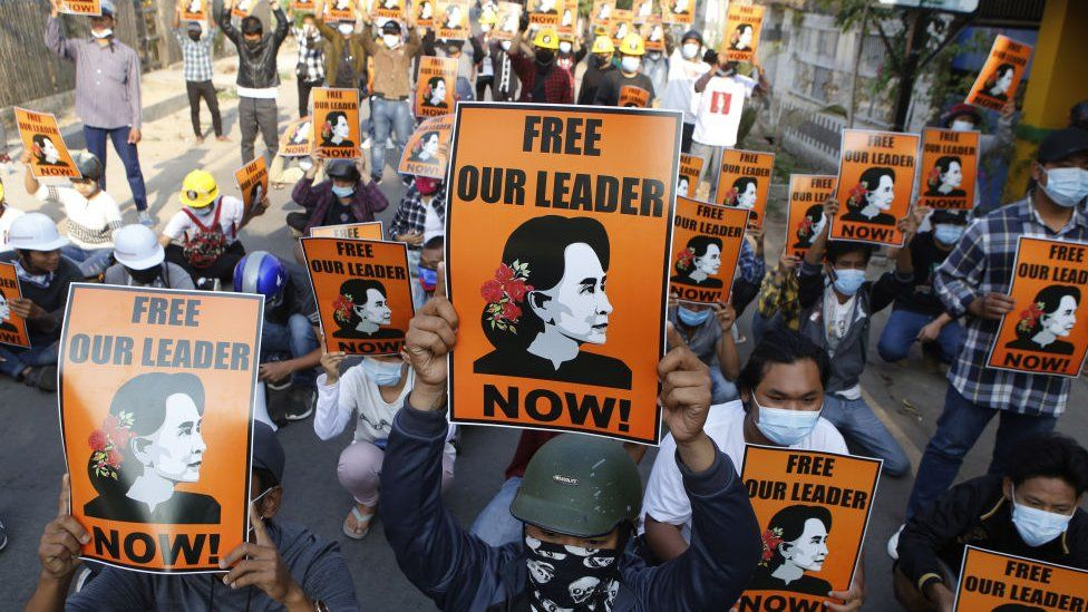 Protesters hold up placards demanding the release of detained Myanmar civilian leader Aung San Suu Kyi