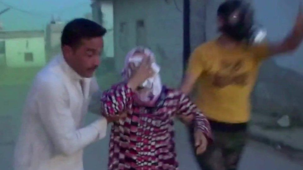 Syrian people run amid an alleged chlorine gas attack