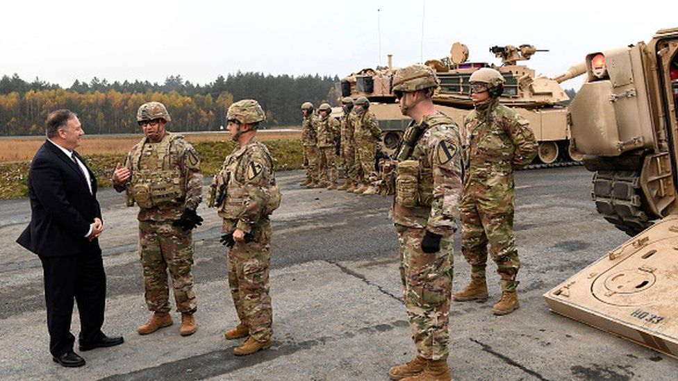 US Secretary of State Mike Pompeo talks to US soldiers as he visits the military base in Grafenwoehr, Germany, in 2019