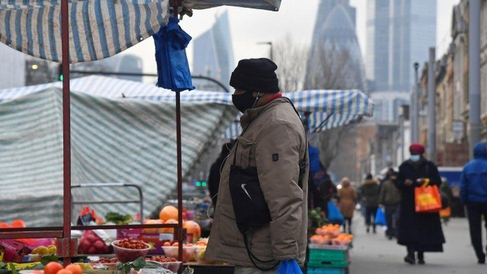 Man at market stall near City of London