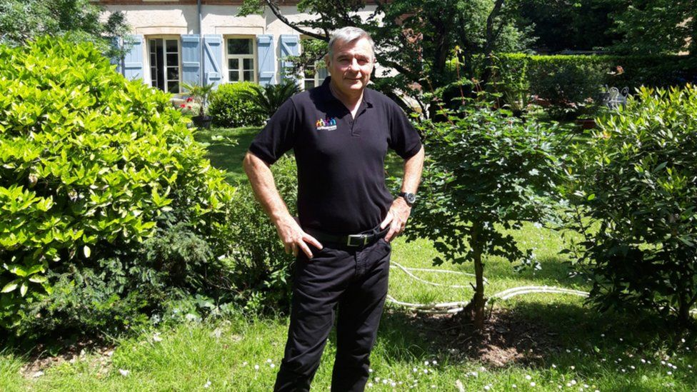 Alain Brault outside his home