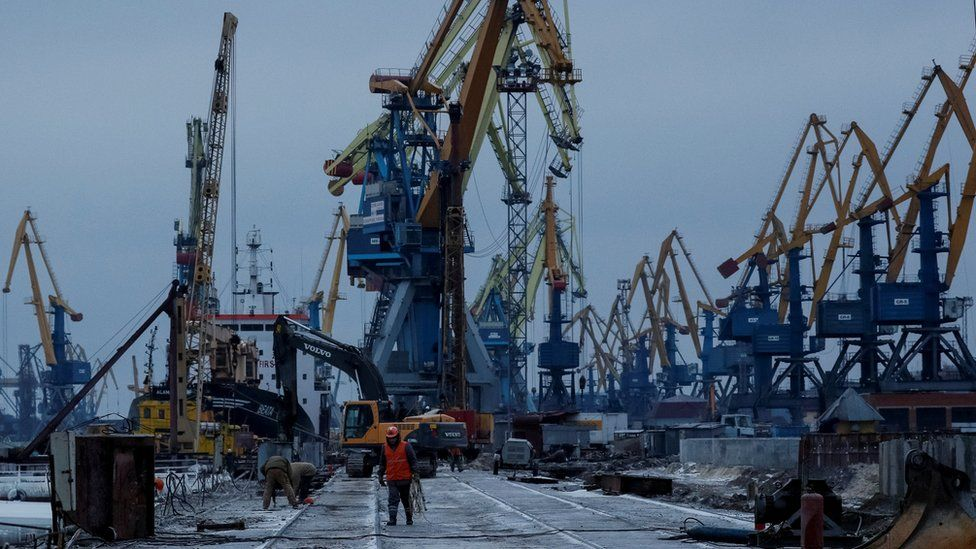 Cranes are seen in huge numbers in a bleak and cold port - with very little activity taking place