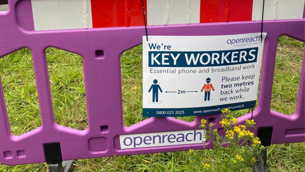 An Openreach key workers sign asks others to maintain distance while its staff do their job
