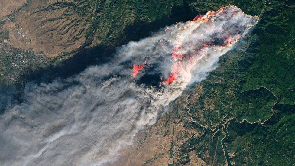 This NASA Earth Observatory handout image taken on November 8, 2018 and released on November 10, 2018 shows the Camp Fire burning in Paradise, California