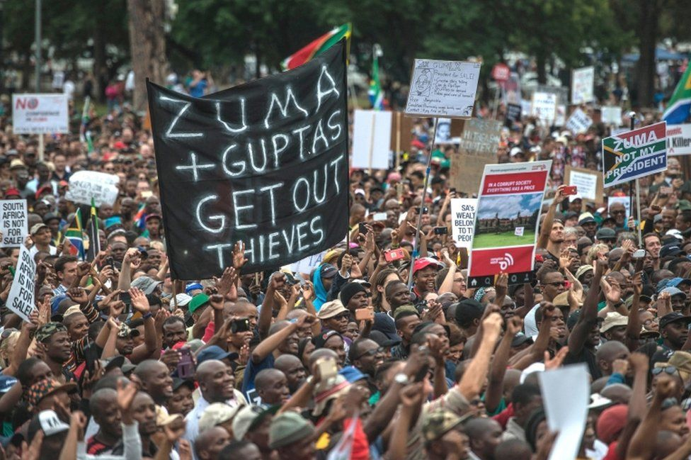 Tens of thousands of South Africans from various political and civil society groups march to the Union Buildings to protest against South African president and demand his resignation on April 7, 2017 in Pretoria.