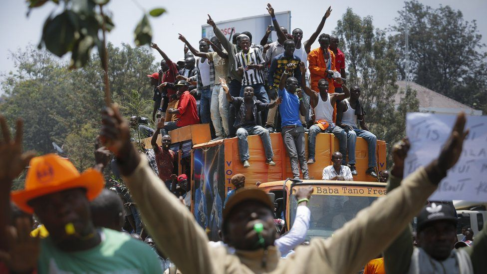 """Supporters of the opposition coalition The National Super Alliance (NASA) and its presidential candidate Raila Odinga sit on top of a truck during their protest against the country""""s electoral body Independent Electoral and Boundaries Commission (IEBC) in downtown Nairobi, Kenya, 26 September 2017"""