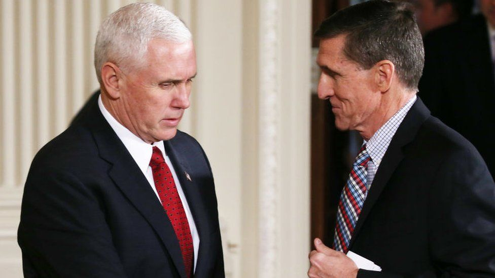 Vice-President Mike Pence and Michael Flynn shake hands.