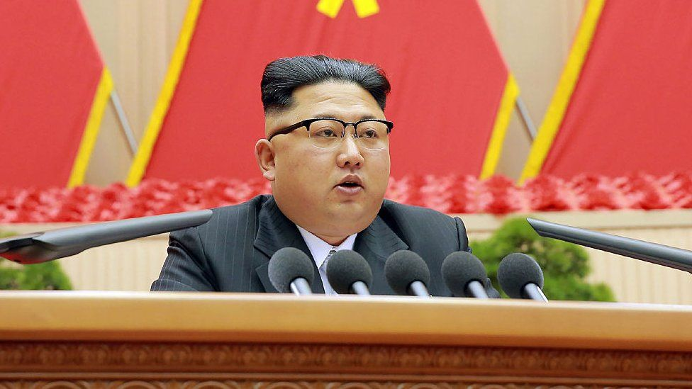 North Korean leader Kim Jong-Un (C) delivering a speech at the First Conference of Chairpersons of the Primary Committees of the Workers' Party of Korea (WPK)