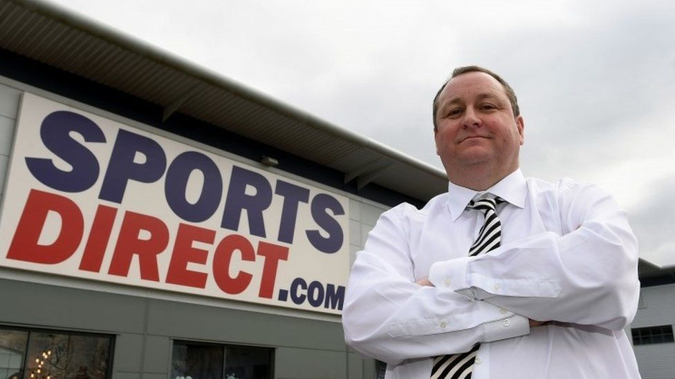 Mike Ashley standing outside his warehouse in Derbyshire