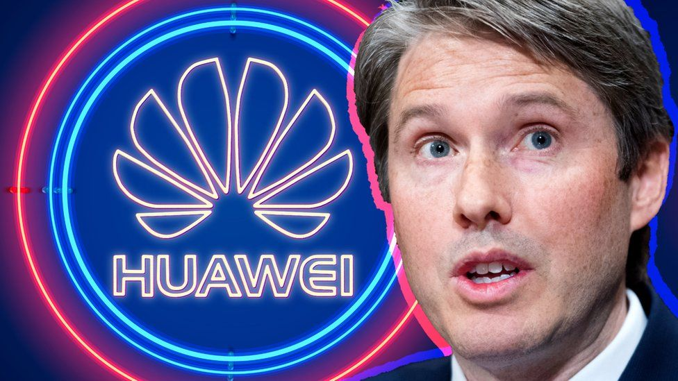 Robert Strayer in front of the Huawei logo