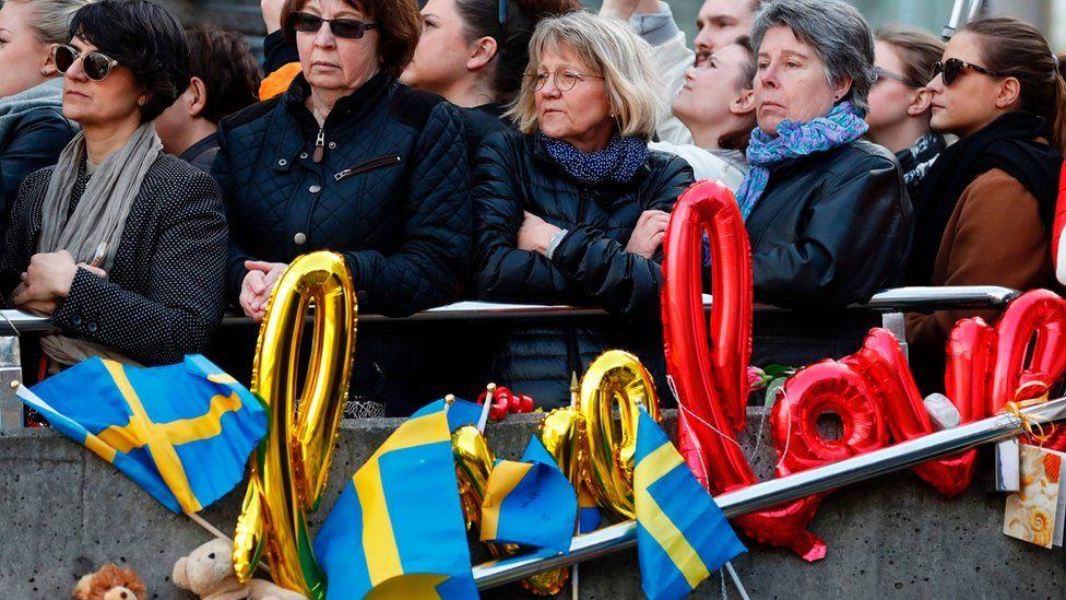 People attend a memorial ceremony at Sergels Torg plaza in Stockholm, Sweden on April 9, 2017