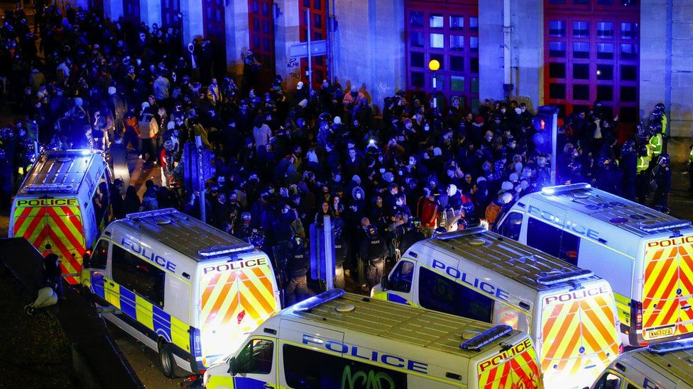 Lines of police vans and protesters in Bristol