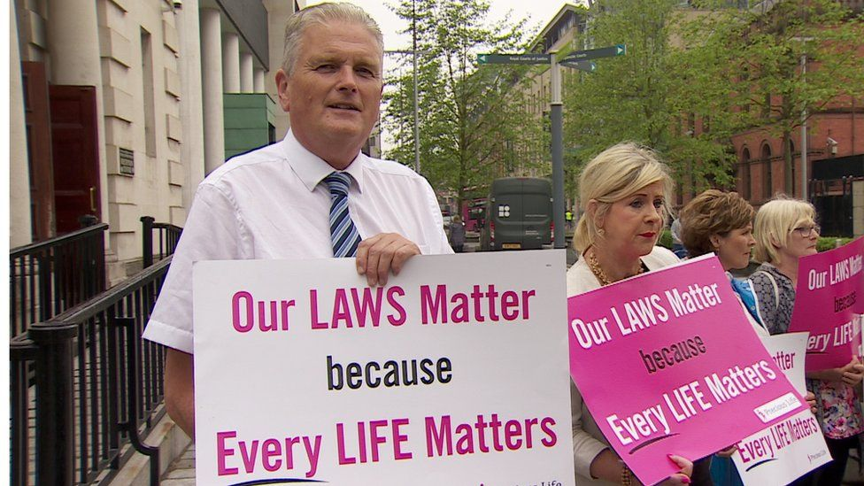 DUP politician Jim Wells and pro-life campaigner Bernie Smyth hold up anti-abortion signs