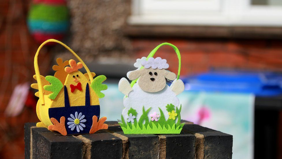 Easter decorations displayed on a wall in Northampton