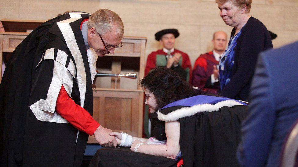 Melanie Hartshorn receives her degree certificate at Newcastle University