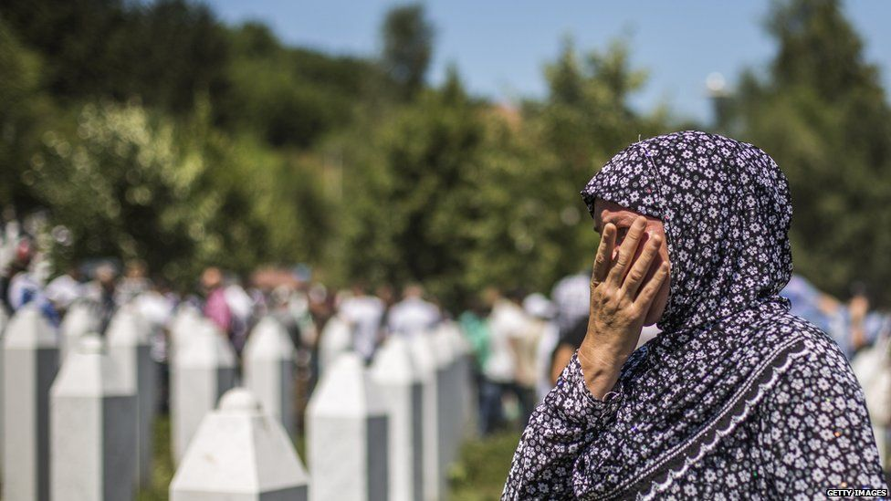 A woman mourns after the mass funeral for 136 newly-identified victims of the 1995 Srebrenica massacre attended by tens of thousands of mourners during the 20th anniversary of the massacre at the Potocari cemetery and memorial on 11 July 2015 in Srebrenica, Bosnia and Herzegovina